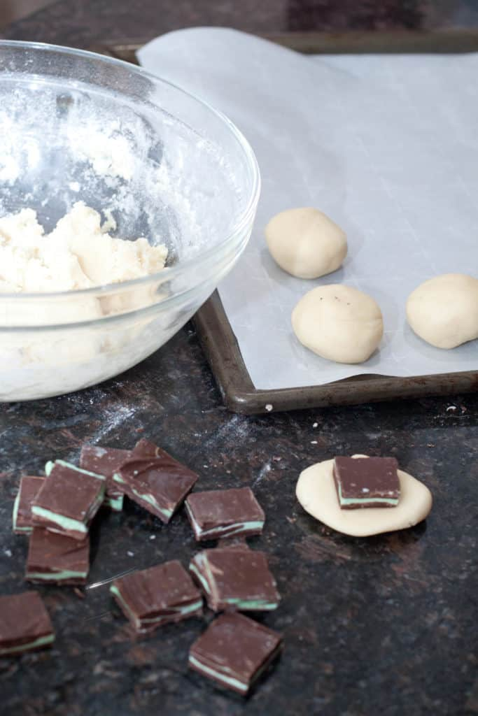 Homemade Andes Mints plus a classic sugar cookie and you have Andes Stuffed Sugar Cookies! All the classic taste of your favorite sugar cookie with the surprise of ooey gooey chocolate mint inside!
