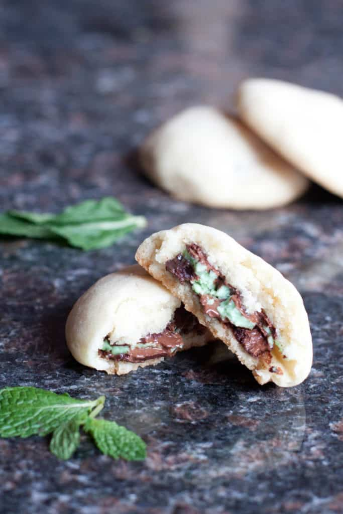 sugar cookies with andes mint inside and half a cookie open