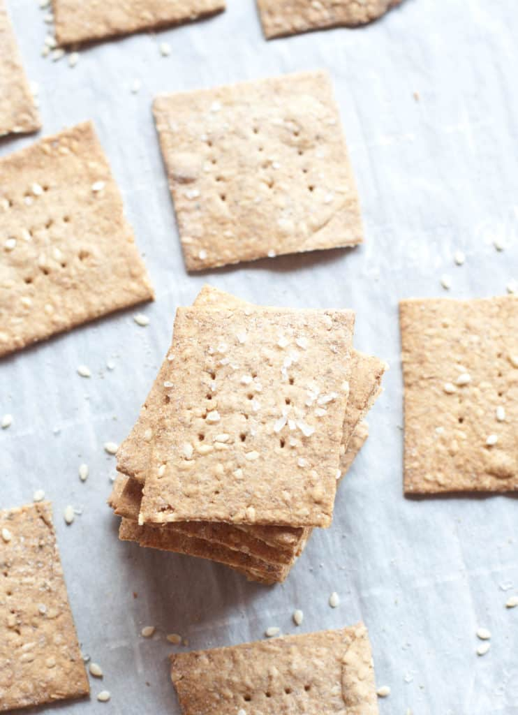 stacked crackers on parchment paper