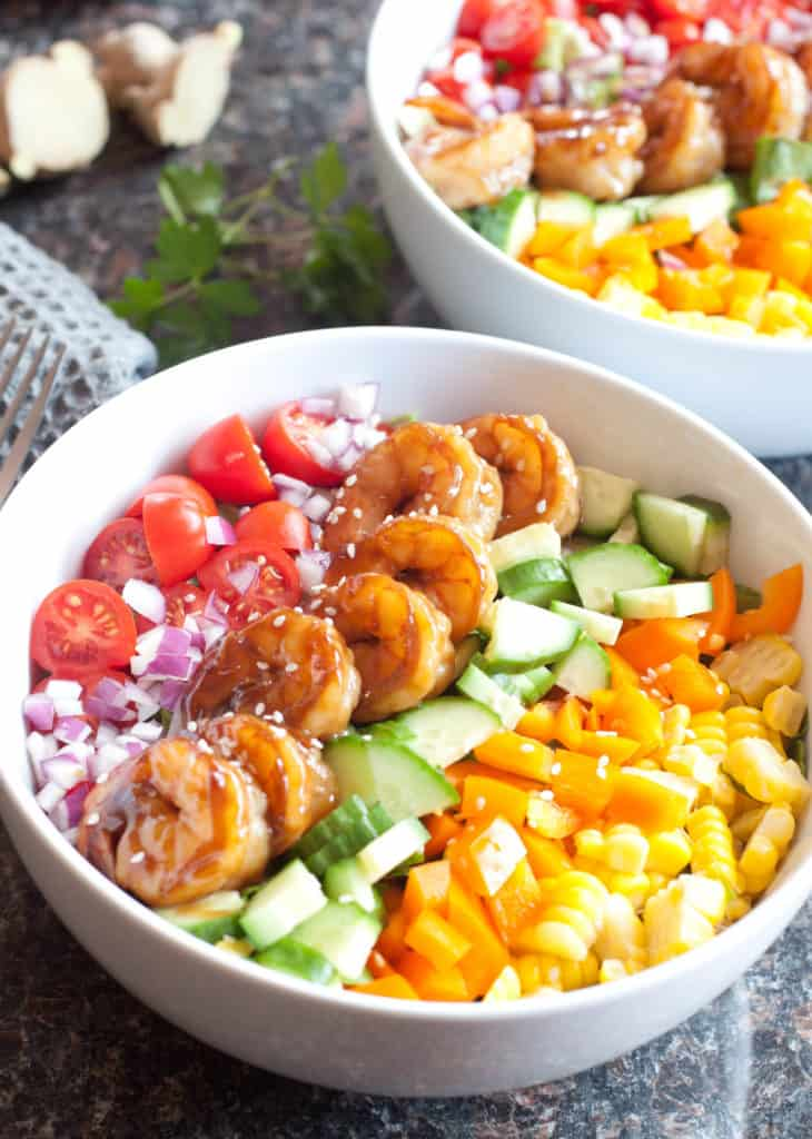 bowl with shrimp and colorful chopped vegetables
