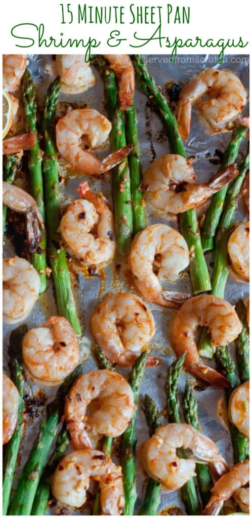 cooked shrimp and asparagus on a sheet pan with Pinterest pin text.