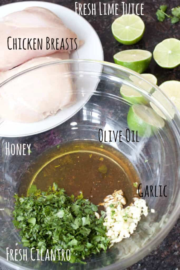 raw chicken, fresh cut limes, and a bowl of honey, olive oil, cilantro, and minced garlic