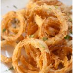 cooked crispy onion rings from scratch on a plate