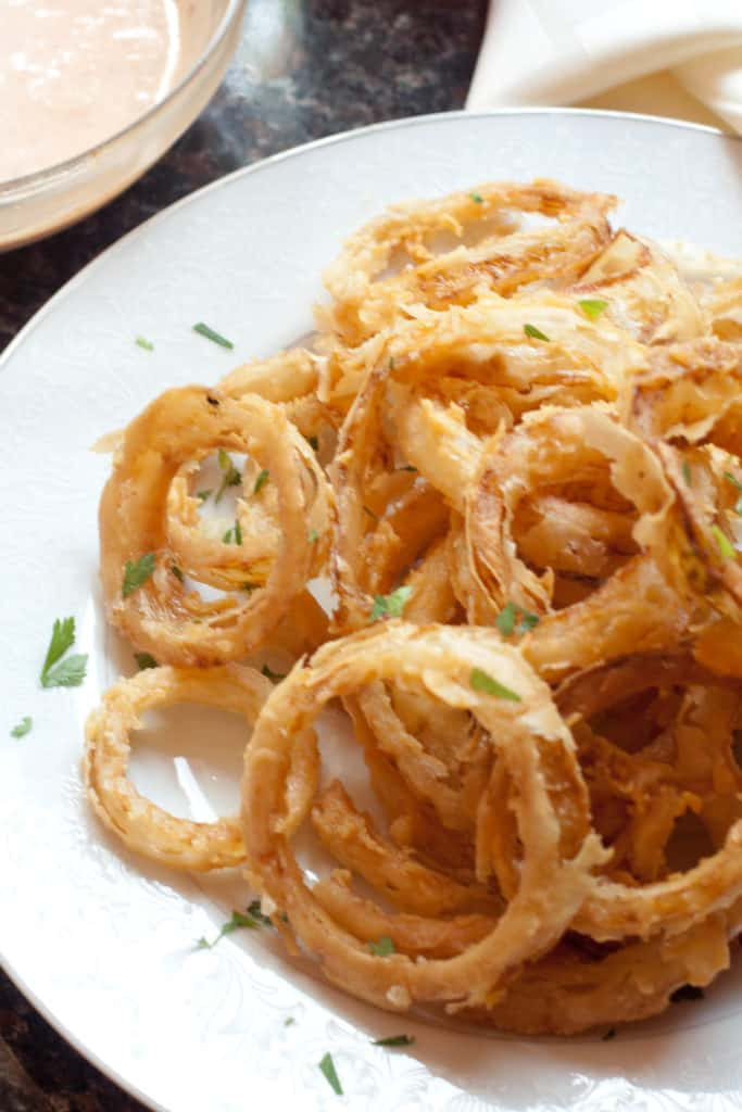 a plate of crispy onion rings