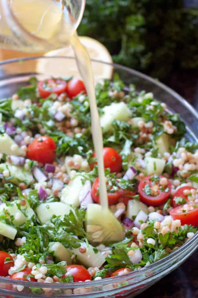This Israeli Couscous Cucumber Salad is vegan friendly refreshing summer salad that's bright and light with fresh herbs and summer garden vegetables!