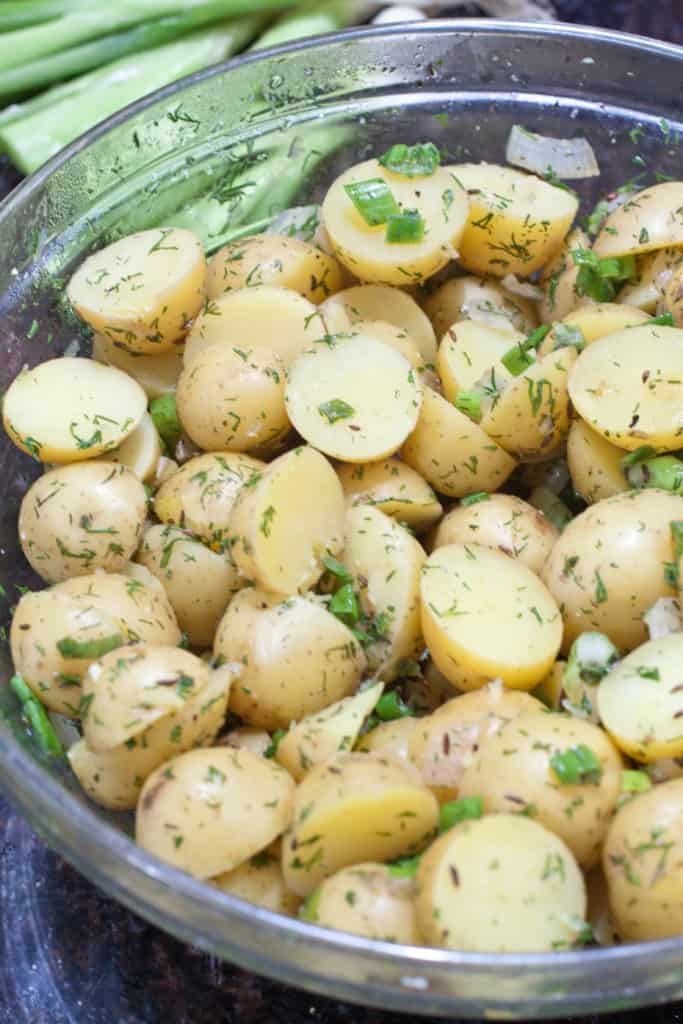 Fresh dill and some tangy vinegar make this German Dill Potato Salad a bright, fresh summer potato salad that's vegan, gluten free, and perfect for all outdoor gatherings!
