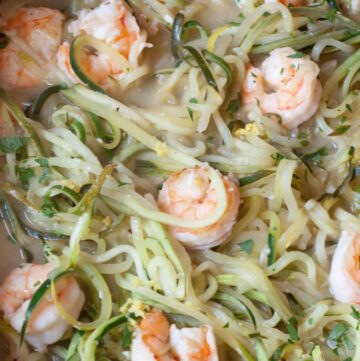 a pan of zucchini noodles and shrimp.