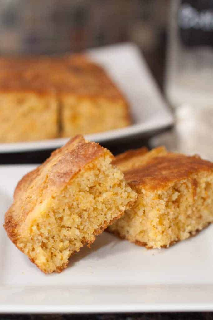 two pieces of cornbread on a plate.