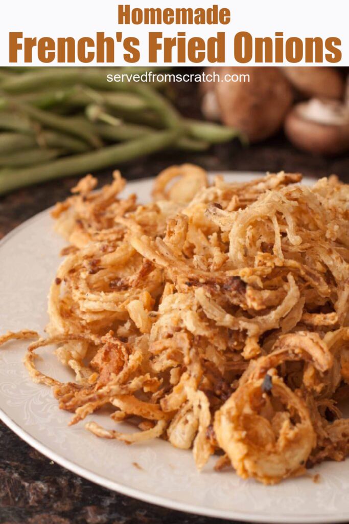 a plate of crispy fried onions with Pinterest pin text.