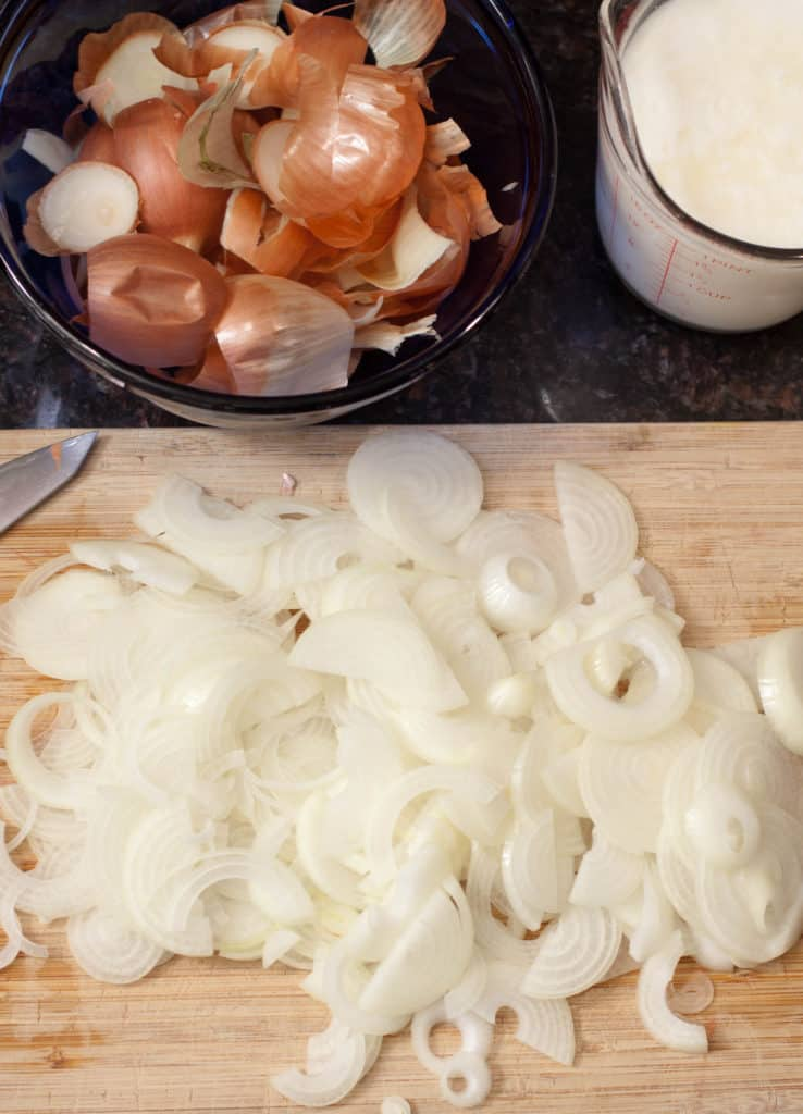 Sliced onions on a cutting board