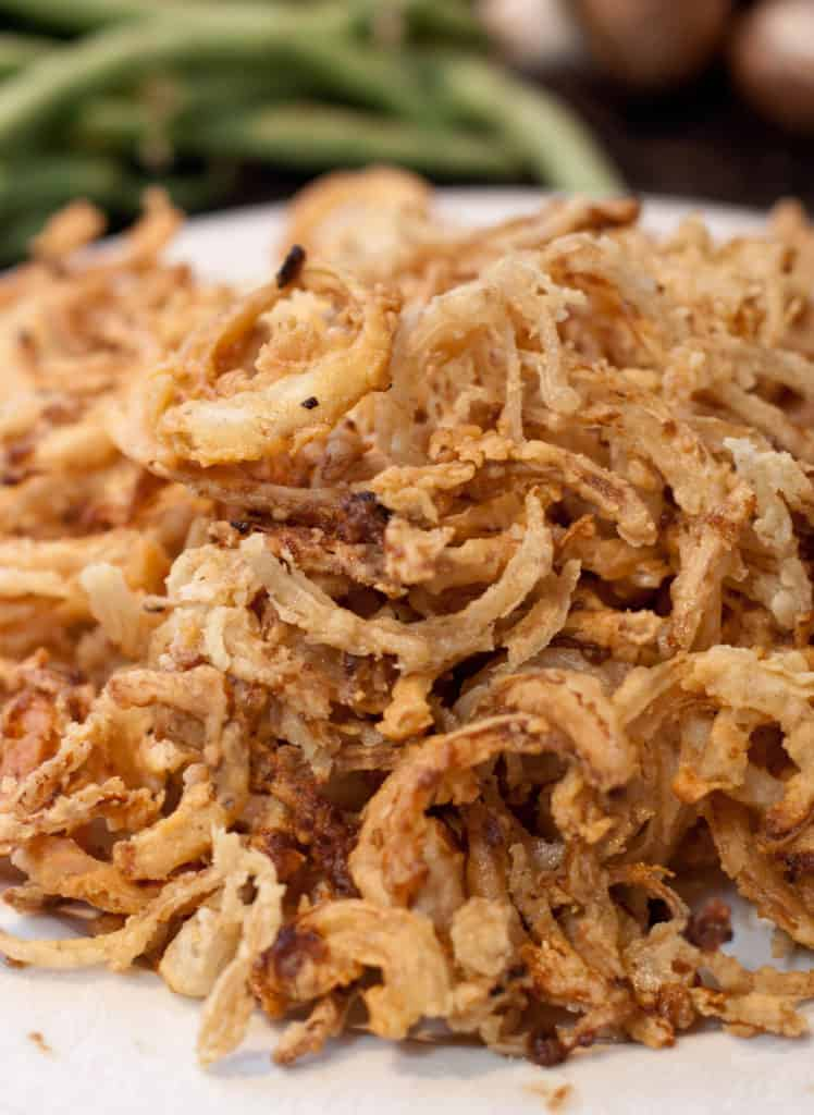 a close up of a plate of crispy fried onions