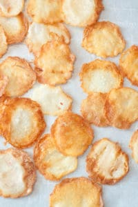 fresh made potato chips on parchment paper