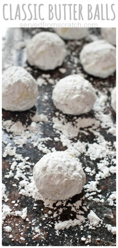 sugar coated butter ball cookies on a sugared counter