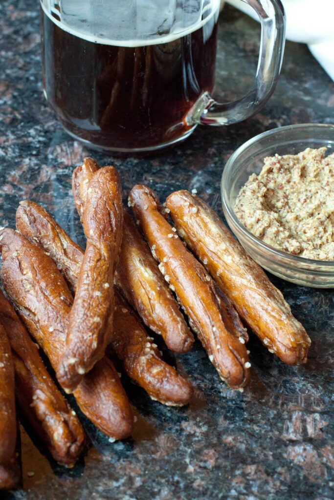By making your own snack foods you make them healthier and much more fun to eat. Try your own Hard Pretzel Rods From Scratch!