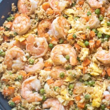 cauliflower shrimp fried rice in a large saute pan cooked