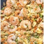 """Watching your carbs? Then this Cauliflower Shrimp Fried """"Rice"""" is the perfect, healthy, quick and easy meal that'll satisfy that fried rice craving, without the rice! #cauliflowerfriedrice #recipe #easy #shrimp"""