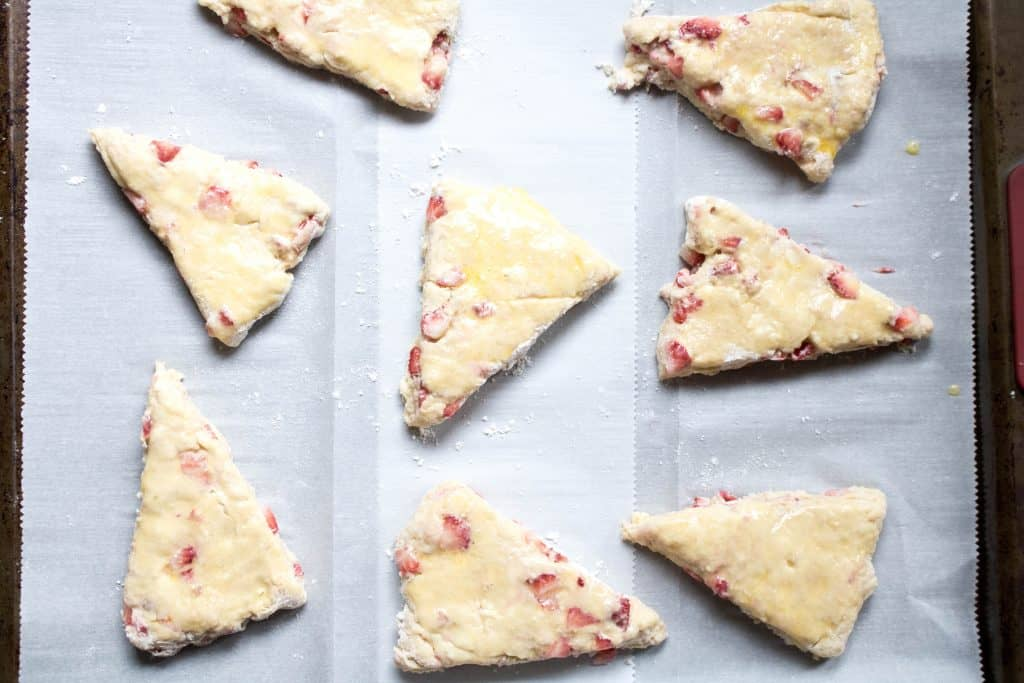 raw scones on a parchment lined baking sheet
