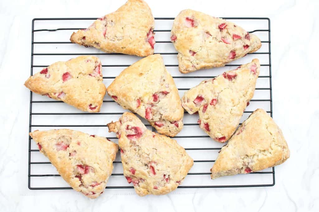 cooked strawberry scones on a cooling rack