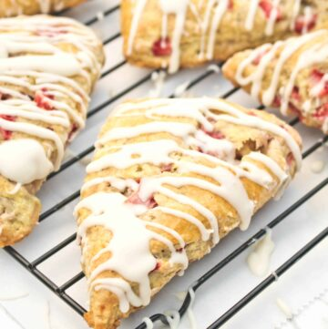 glazed scones with strawberries on a cooling rack