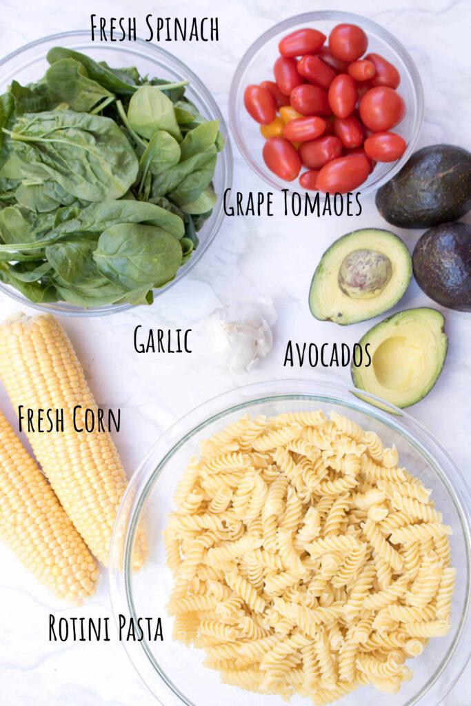 corn on cob, spinach, tomatoes, pasta, garlic, and avocados.