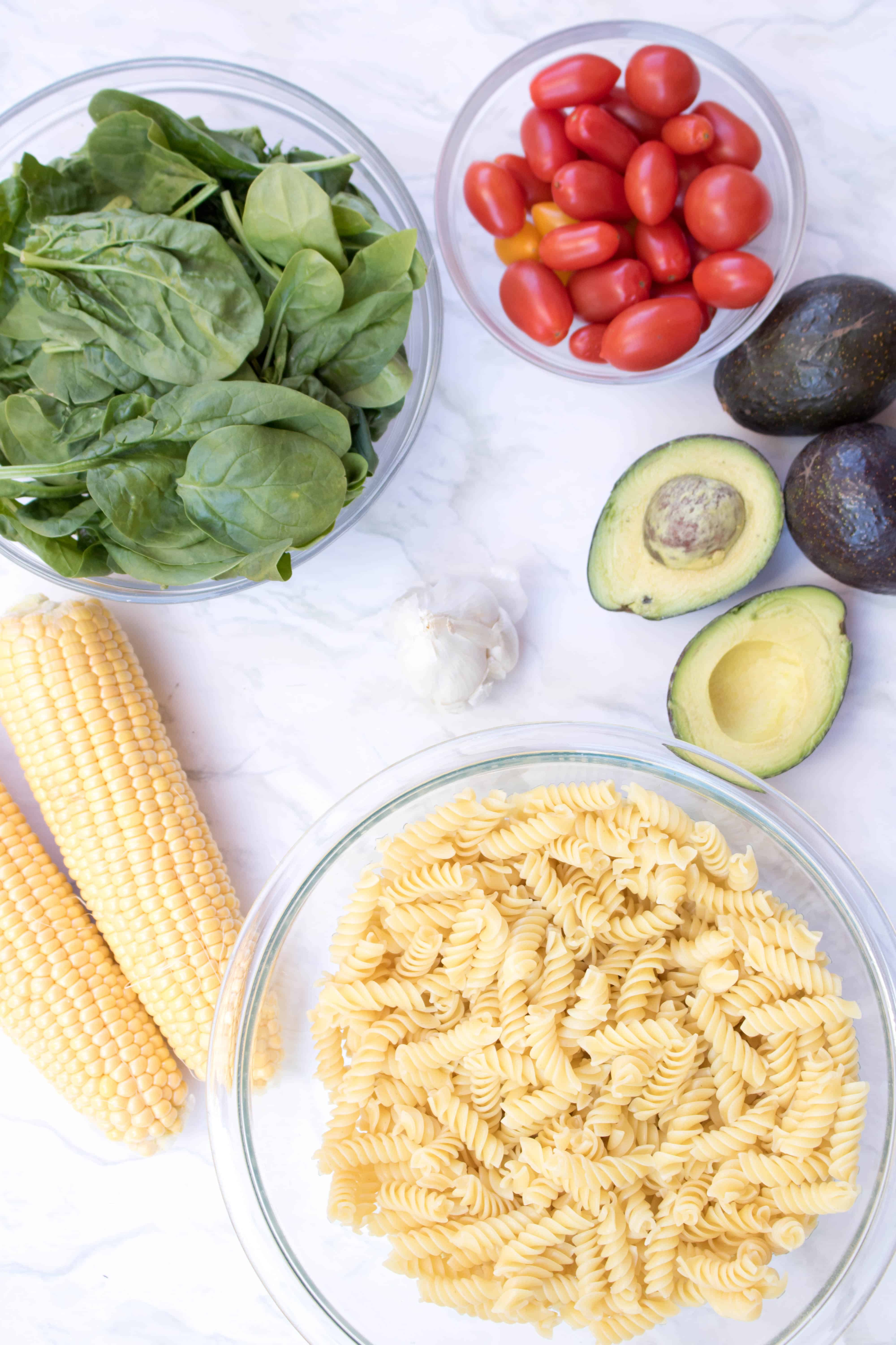 This Avocado Pasta salad is one that'll be different than all the others on the cookout table.  It's creamy, bright, packed full of (hidden) spinach, and it just happens to be vegan friendly!