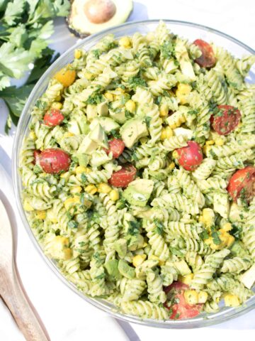 overhead of a bowl of green pasta salad