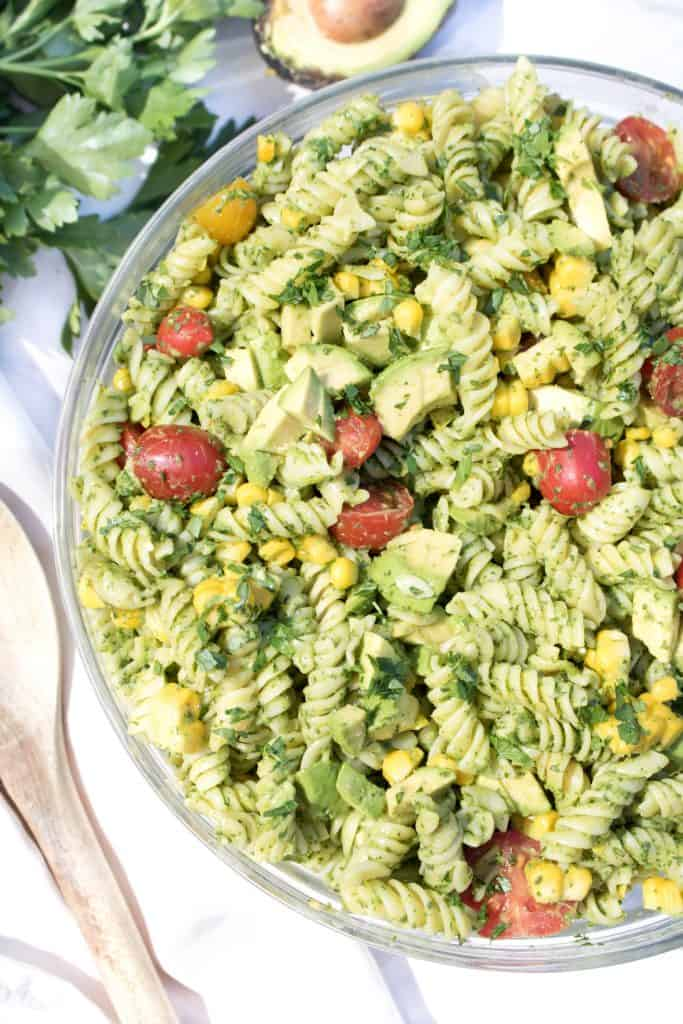overhead of a bowl of green pasta salad.