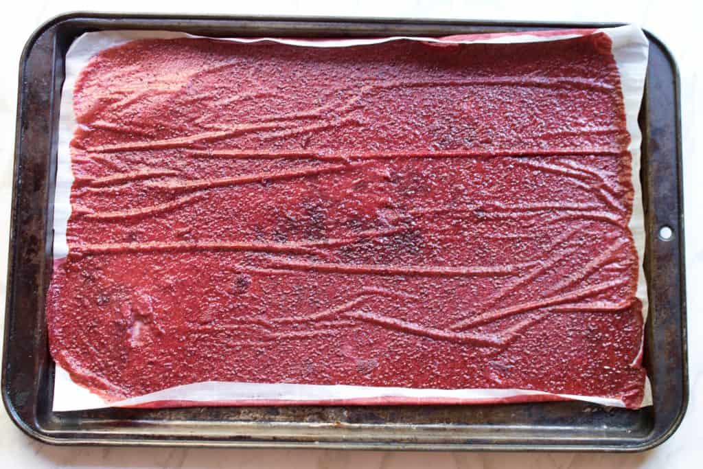 fresh out of the oven dehydrated strawberry fruit roll ups on baking tray