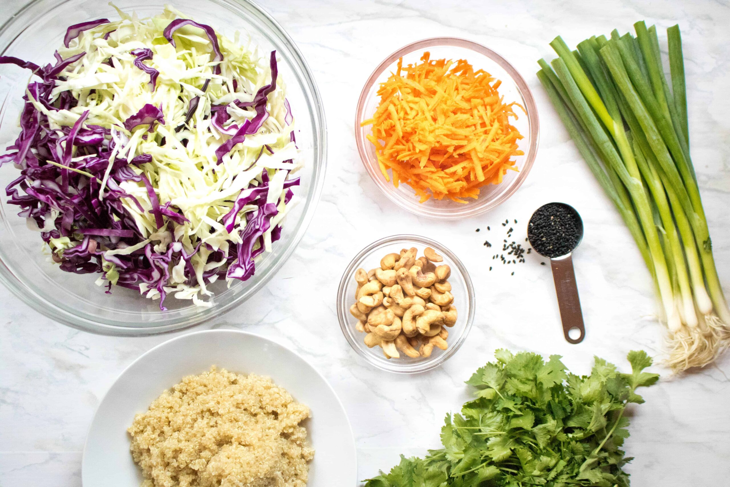 This Asian Sesame Ginger Slaw isn't your average slaw!  It's heartier with the addition of quinoa, but also mayo free and lighter with a delicious sesame ginger dressing!