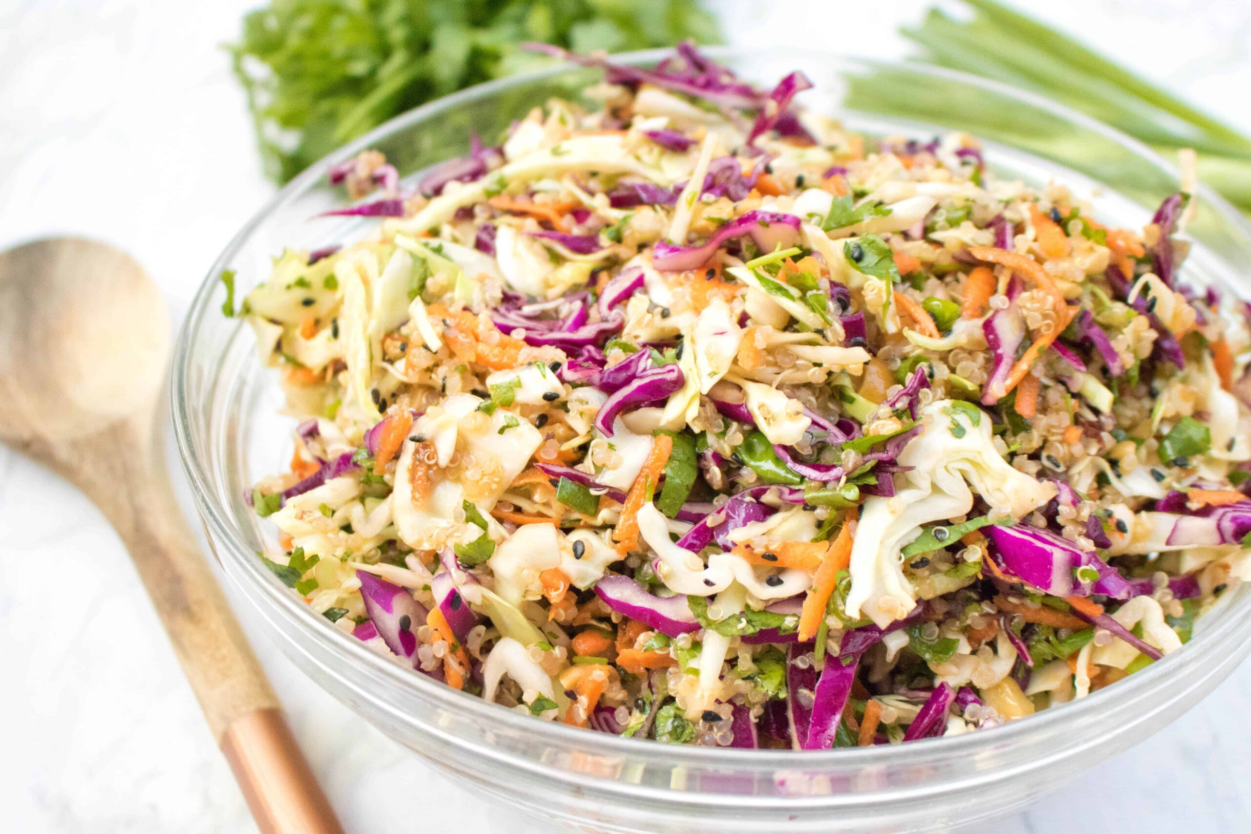 This Asian Sesame Ginger Slaw isn't your average slaw!  It's heartier due to the addition of quinoa, but also mayo free and lighter with a delicious sesame ginger dressing!