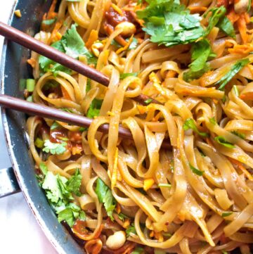 cooked sweet and spicy noodles in a pan with chopsticks