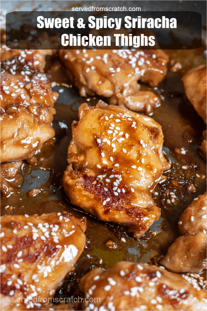 cooked glazed chicken thighs topped with sesame seeds in a pan with Pinterest pin text.