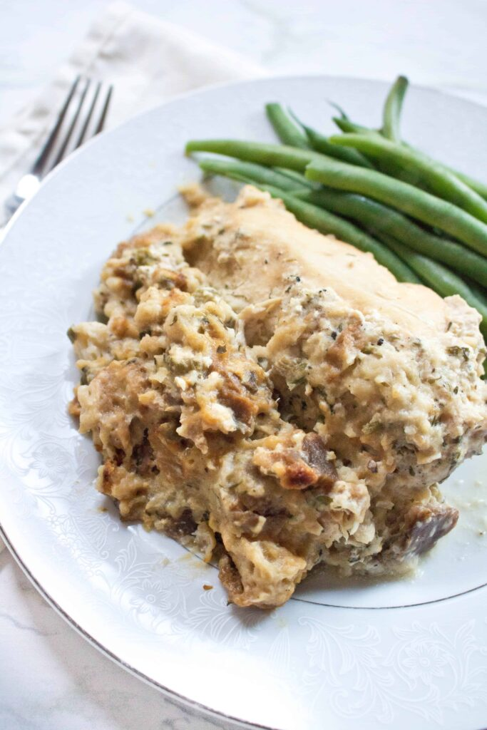 a plate of chicken and stuffing with green beans