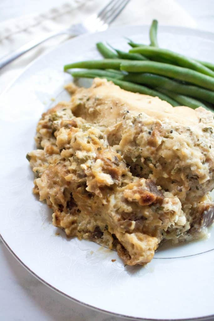 a plate of cooked chicken adn stuffing