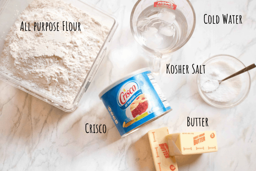 flour, butter, crisco, water, salt on a counter