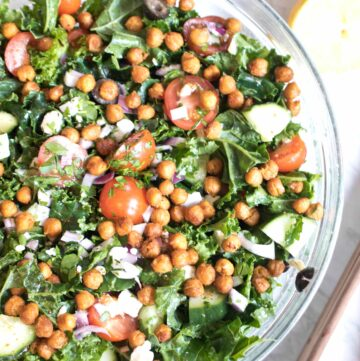 bowl with kale, tomatoes, cucumbers, feta, and chickpeas