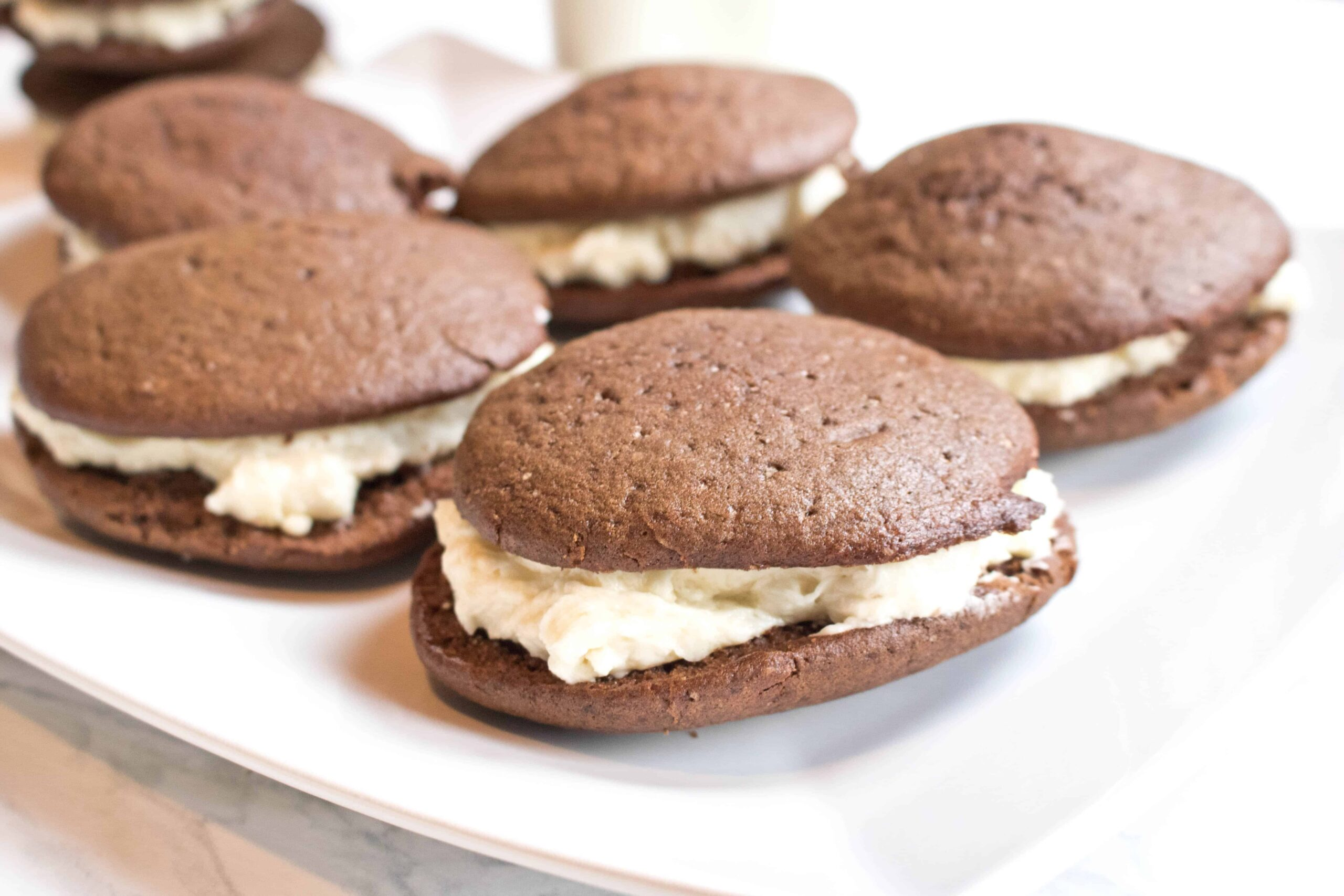 A New England Classic!  These Whoopie Pies From Scratch are two soft chocolate cookies sandwiching a Grandma Pearl's Miracle Frosting!