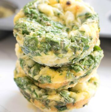 3 stacked egg cups with spinach