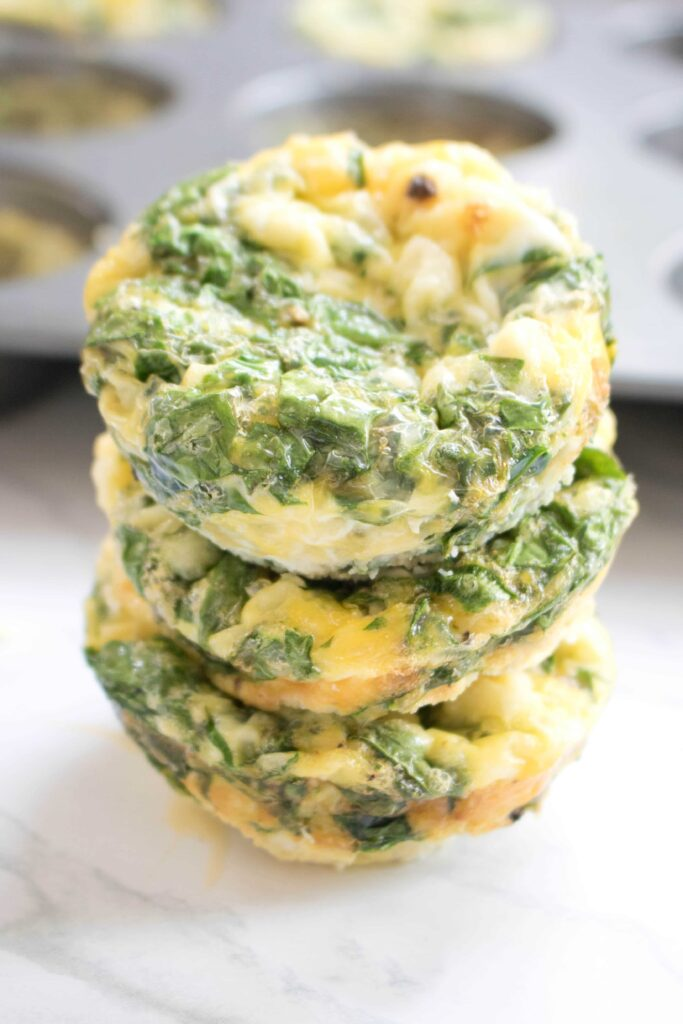These Spinach and Feta Egg Cups are a delicious, easy to make grab n go breakfast that's packed full of nutrition and flavor!