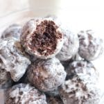 Easily made at home from scratch, these Copycat Glazed Chocolate Munchkins are the perfect snackable little donut hole! #chocolatedonuts #easy #munchkins #copycat #dunkindonuts #recipe #chocolate #glazeddonuts #donutholes