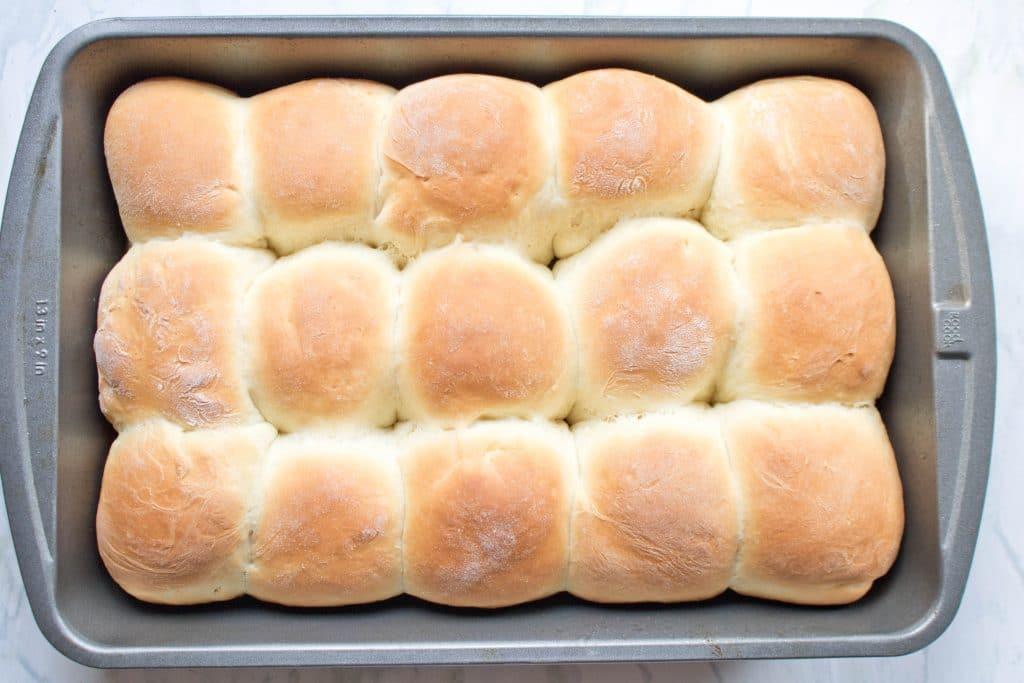 fresh baked dinner rolls in pan