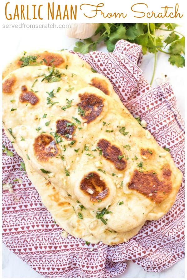 naan with melted butter and garlic on a red napkin.