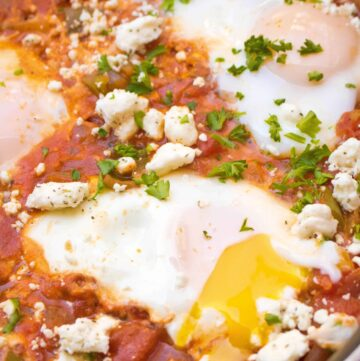 Your new favorite brunch! This Homemade Shakshuka is an easy to make one pan dish of poached eggs in a flavorful tomato, pepper sauce!