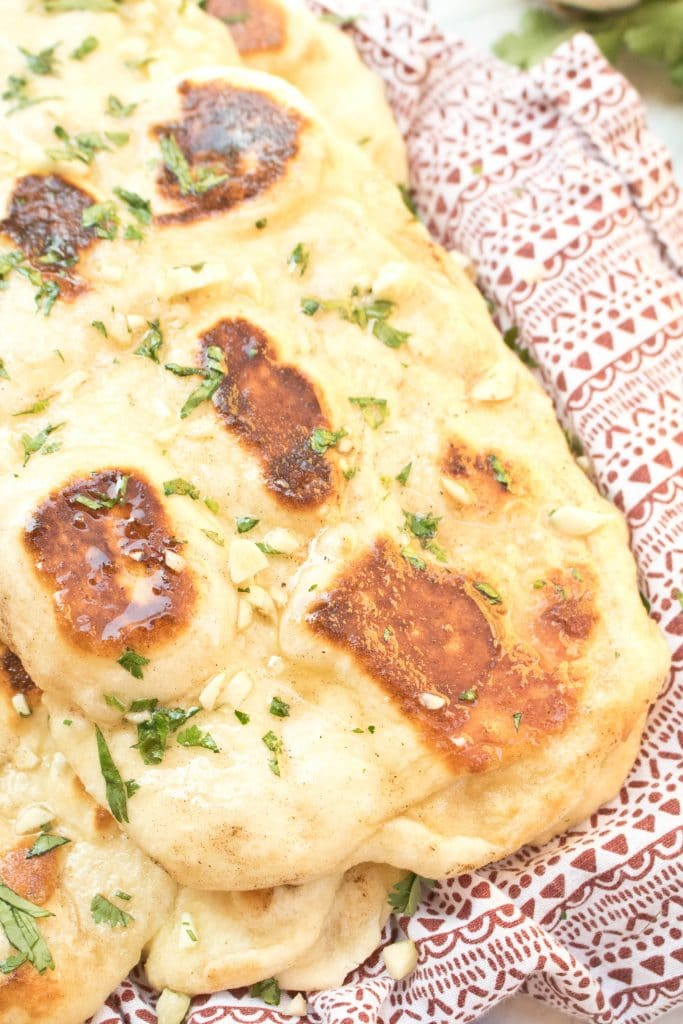 a plate of naan with butter and garlic.