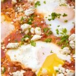 Your new favorite brunch! This Homemade Shakshuka is an easy to make one pan dish of poached eggs in a flavorful tomato, pepper sauce! #shakshuka #brunch #recipe #easy #traditional #feta #eggs