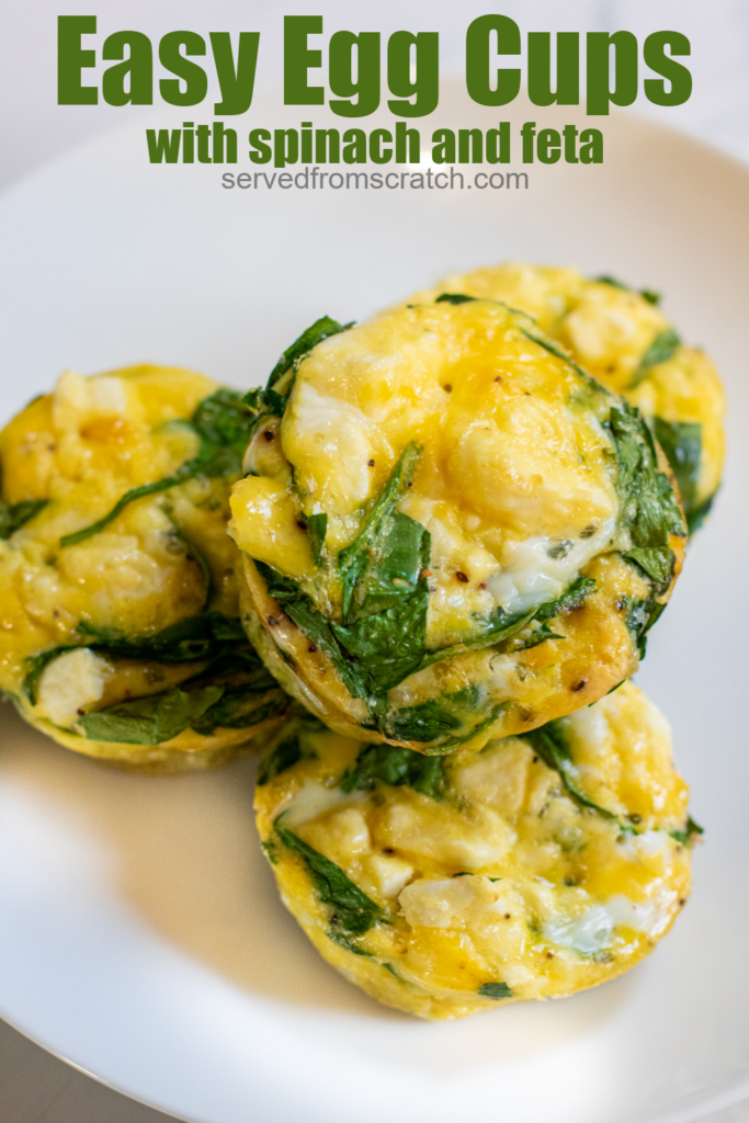 a plate of cooked egg cups with spinach and pinterest text.
