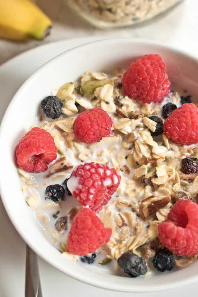 A bowl of muesli with fresh raspberries