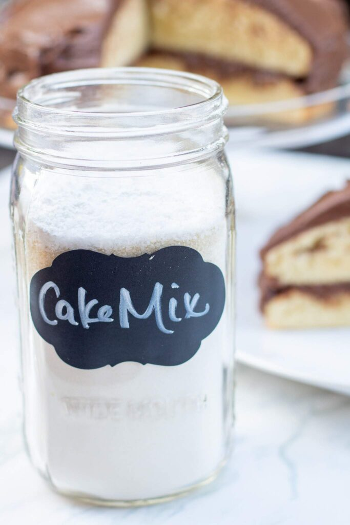 mason jar of cake mix in front of a cake