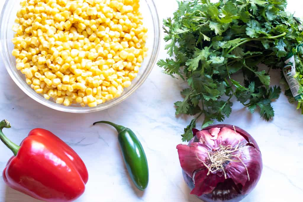 This Mexican Street Corn Salad turns the classic Mexican street food into a delicious and easy to make side dish!