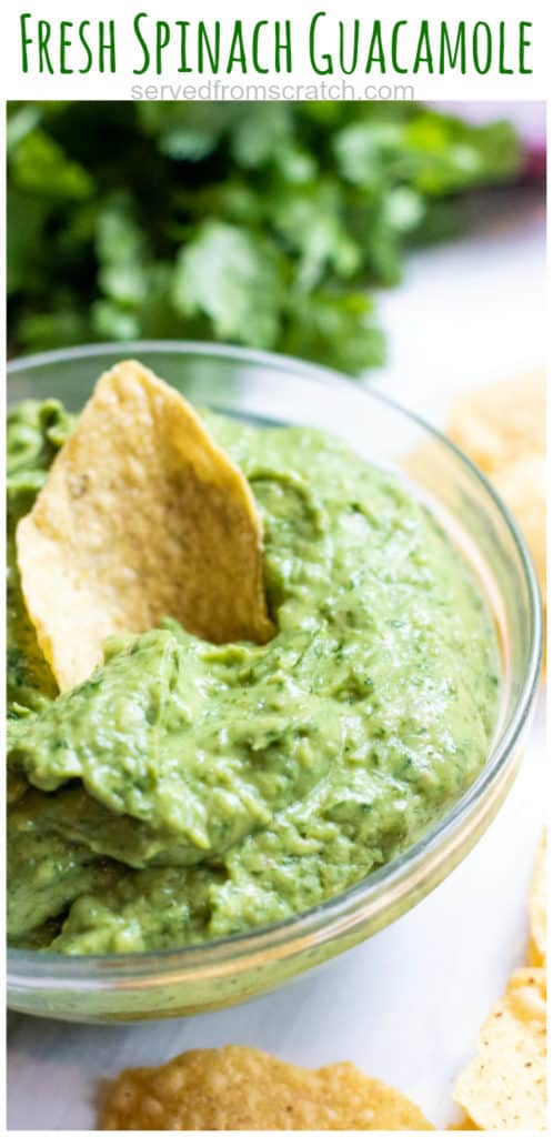 a bowl of guacamole with a chip and Pinterest pin text.